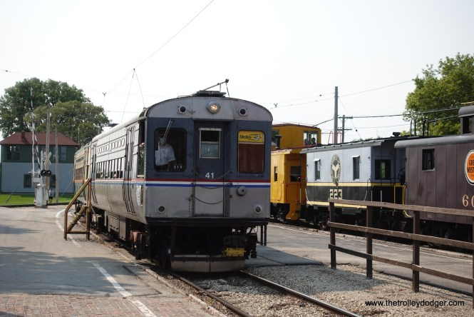 CTA single car units 41 and 30 were operating as a pair. The former with trolley poles, and the latter with a Skokie Swift pantograph.