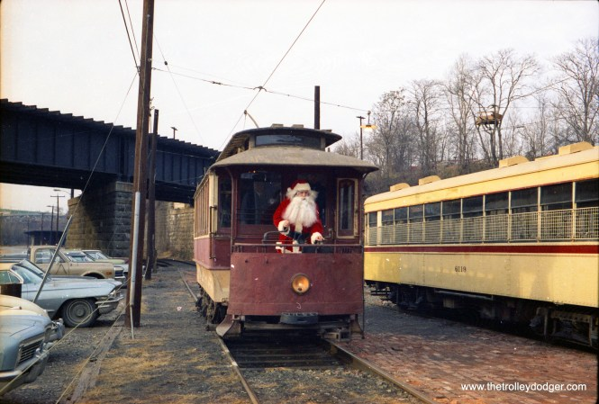 Santa Claus arrives by trolley at the Baltimore Streetcar Museum, sometime in the 1970s. It probably wasn't July, though. (John Engleman Photo)