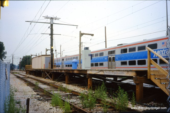 Blue Island, IL on September 6, 2001. This two-car section of the Blue Island (Vermont Street) Metra (IC) Electric station platform is all that's left of the original 1926 station. The head house and remainder of the platform have been demolished and a new facility is under construction. The view looks N-NE across the west pocket track.