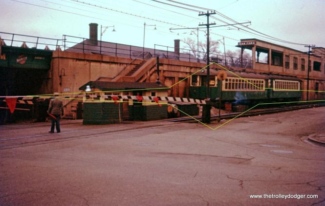 """A nice view of a gateman's shanty on the ground level portion of the Lake Street """"L"""" in Oak Park. All 22 grade crossings here were manually operated."""