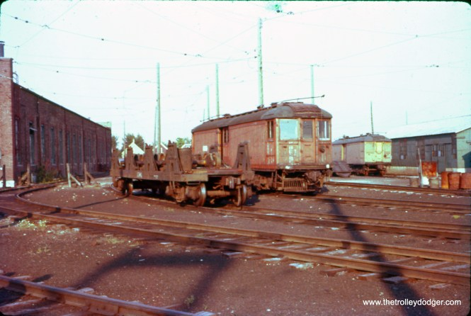 This is a view of the North Shore Line's Harrison Street Shops in Milwaukee in the late 1950s, taken from an early Ektachrome slide that has unfortunately shifted to red. I did what I could to improve the color. Not sure which express motor car that is.