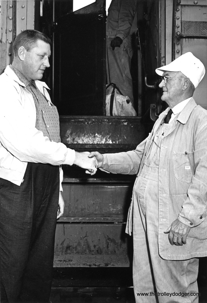 Carl Edward Hedstrom Jr. congratulating Carl Edward Hedstrom Sr. on his retirement as a South Shore Line motorman in Michigan City, Indiana on October 30, 1960. Junior also worked as a motorman from about 1939 to 1983. (Michigan City News Dispatch Photo)