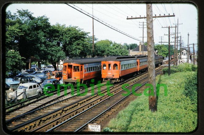 FYI, this original slide recently fetched $100.99 on eBay. Chicago Aurora & Elgin 456 and 314 in Wheaton, sometime around 1952-55. We are looking west.