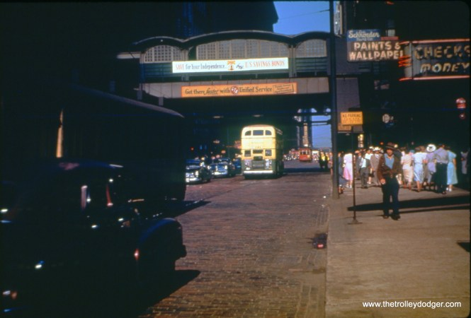 Washington and Wells, looking east, on June 8, 1950. Milwaukee Avenue buses share the street with a Chicago Motor Coach double-decker. (William C. Hoffman Photo, William Shapotkin Collection)