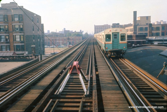 """The view looking south from the 35th Street """"L"""" station on August 23, 1963. A new center island station had opened here in 1961, taking up space formerly occupied by the center express track, which had been unused after 1949. A fire destroyed the new station in October 1962, and temporary facilities were used until the station was rebuilt in 1965. (William C. Hoffman Photo)"""