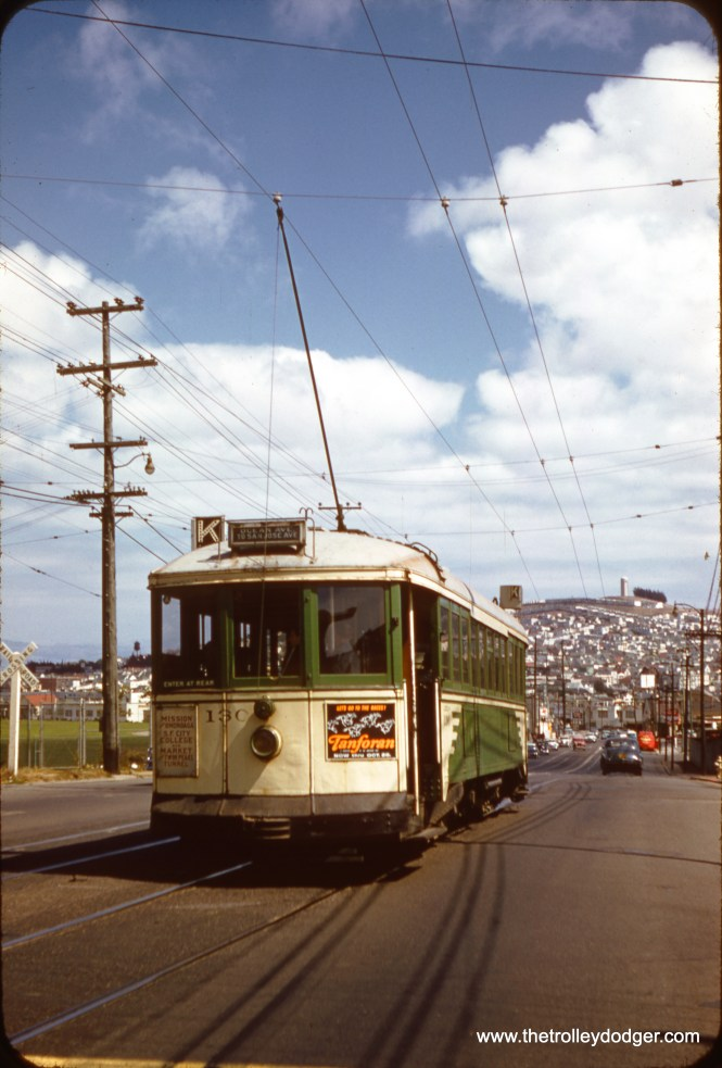 """SF Muni 130 on Ocean Avenue by Elkton Shops on September 16, 1957. According to the Market Street Railway web site: """"Car No. 130 was among the the last 'Iron Monsters' to leave passenger service, in 1958. Muni shop foreman Charlie Smallwood saved it from the scrap heap by hiding it in the back of Geneva carhouse while its mates met their fates. He then talked his bosses into making it a 'wrecker'. Stripped bare and painted yellow, it spent the next 25 years towing its replacements–PCC streetcars–back to the barn when they broke down. It was fully restored by Muni craft workers in 1983 for the Historic Trolley Festival, including original seats, which Charlie had kept all those years in his basement…just in case!"""" (Clark Frazier Photo)"""