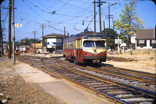 """Red Arrow double-ended car 20, which looks like a PCC but technically isn't, is running outbound on the Ardmore branch in the early 1950s. Not sure what all the track work is about, although the West Chester branch itself was abandoned in favor of buses in 1954, so that West Chester Pike could be widened. I assume this is the intersection of West Chester Pike and Darby Road in Havertown, PA. The Ardmore trolley was replaced by buses at the end of 1966. Both trolley lines here are now SEPTA bus routes. Mark A. Jones adds: """"Regarding the Red Arrow trackage on West Chester Pike west of the Ardmore turn-off, it continued in use after the West Chester line became a bus as the Llanerch car barn (which housed the Red Arrow trolleys at the time) was located Darby Rd. and West Chester Pike west of the Ardmore cut-off. That's my memory of that."""""""