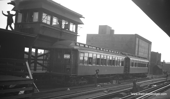 A two-car CTA Kenwood shuttle train at Indiana Avenue, probably some time around 1949. I assume there must have been stairs leading up to the tower.