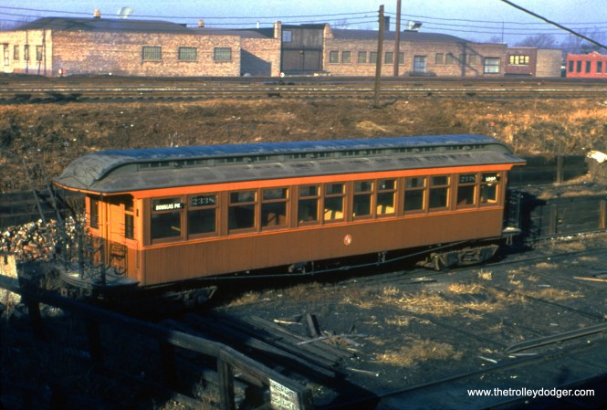 CTA open-platform, railroad roof car 2338 at Kenton on the Douglas Park line, where there was a connection to the Belt Railway of Chicago, in December 1950. (Truman Hefner Photo)