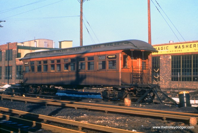"""Open platform, railroad roof car 2715 at 54th Avenue in Cicero, on the Douglas Park """"L"""", in January 1951. (Truman Hefner Photo)"""