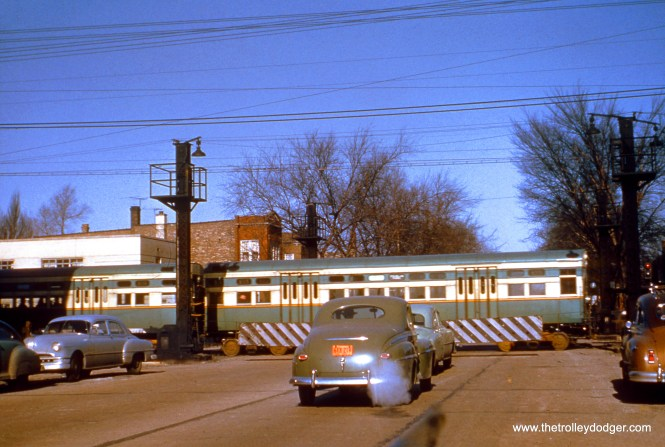 """A train of CTA 6000s (probably 6055-6056) crosses Austin Boulevard in Cicero on the Douglas Park """"L"""" in February 1952, shortly before service was abandoned west of 54th Avenue. (Truman Hefner Photo)"""