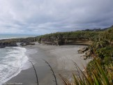 The coast and wind swept rock formations at the end of the Truman Tracki - Driving New Zealand's Wild West Coast - Things to See & Do - The Trusted Traveller
