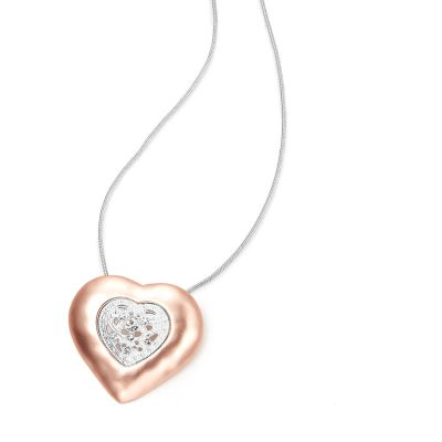 Large two tone heart necklace featuring cut work heart in the center on a snake chain.
