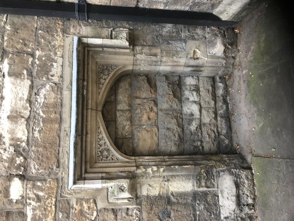 A blocked up doorway. part of the original the Priory of St John.