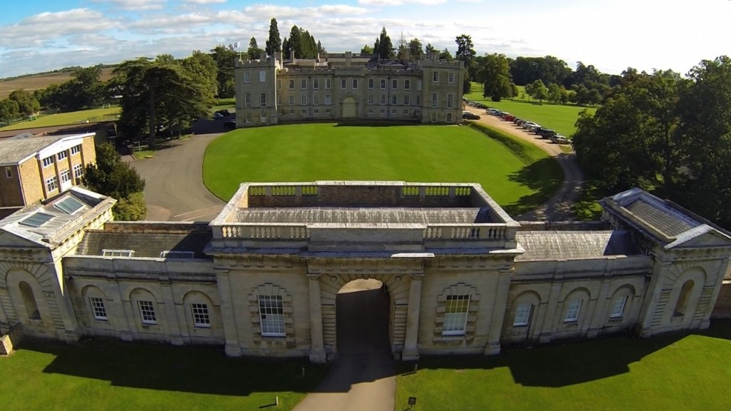 An aerial shot of Kimbolton Castle with the gatehouse in the foreground and the main house in the background