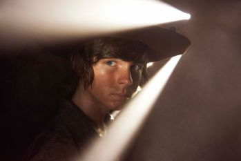 Carl (Chandler Riggs) - Walking Dead, Season Five. CARL, was introduced to the WD life during the heightened value-defining years of an adolescence. Season 4 saw him return from a self-destructive path that would have soon enveloped him in a self-loathing cocoon unable to be penetrated. He could have easily turned into a Merle or, worse, a Governator. His trust in his father is restored, but it isn't the unblinking trust of a little boy who sees his dad as superman. He gets the hard choices adults must make and understands that, sometimes, the consequences may be bad. Photo by Frank Ockenfels - Courtesy of AMC