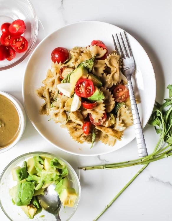 Pesto Pasta Salad with cherry tomatoes, mozzarella, pesto, avocado