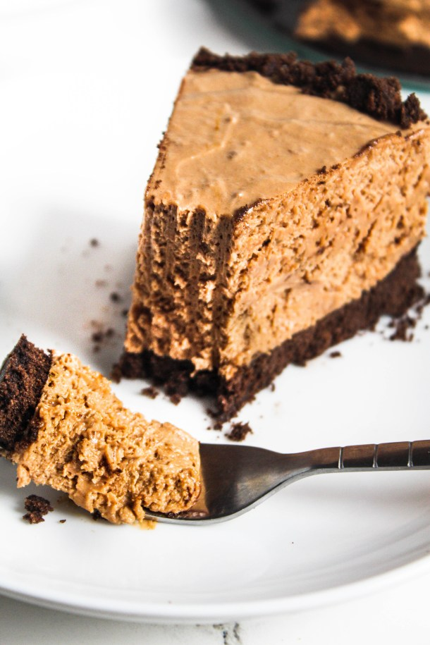 Brown coffee chocolate cheesecake over a white plate.