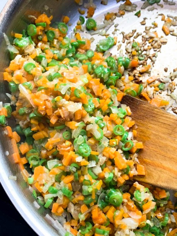 Carrots and Beans cooked in a large frying pan