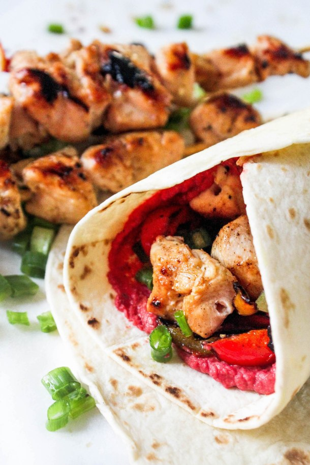 3 Ingredient Lemon Garlic Grilled Chicken skewers on beetroot hummus over flour tortillas - topped with grilled bell peppers wrapped in a roll