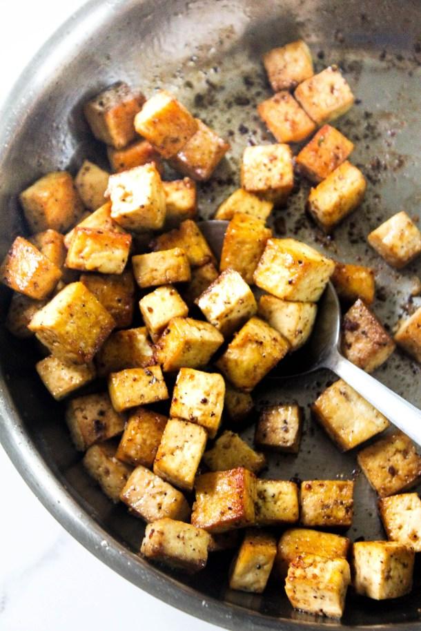crunchy pan fried tofu in a pan
