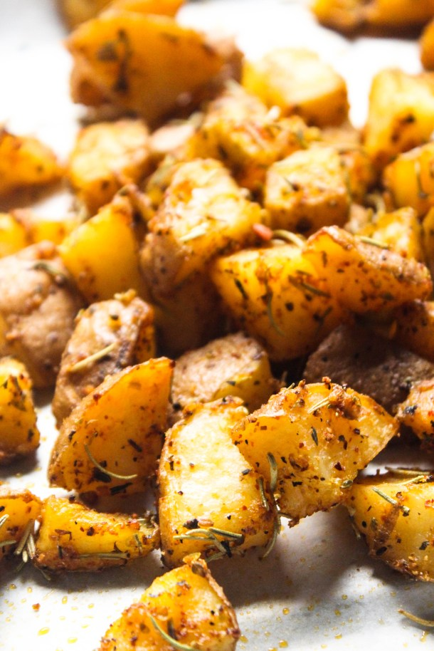 Golden Brown crispy roasted potatoes placed on a baking sheet