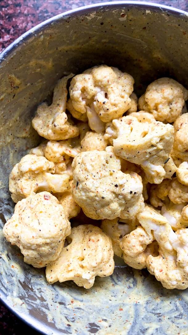 Cauliflower florets covered in yogurt marinade with Indian tandoori spices