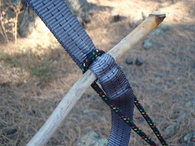 Toggles can also be used for load-bearing hammocks. In this example, the webbing spreads the load across the stick and helps focus compressive forces instead of bending forces, so the stick/toggle doesn't need to be very big. The toggle replaces the need for a carabiner, but it is still a hardware item and very useful for allowing quick adjustment and easy pitching and take-down.