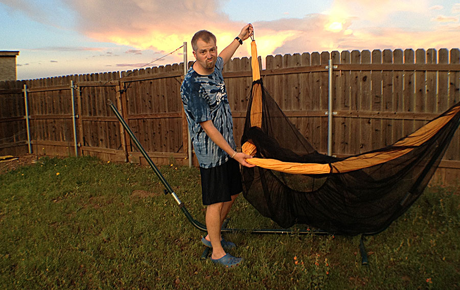 You can easily slide the bug net over the hammock, like a tube, or insert the hammock up from the bottom entry, as shown in this photo.