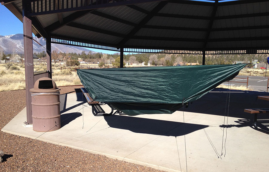 The weather shield deployed as a tarp but without the tent poles. This configuration offers the most rain coverage with the weather shield.
