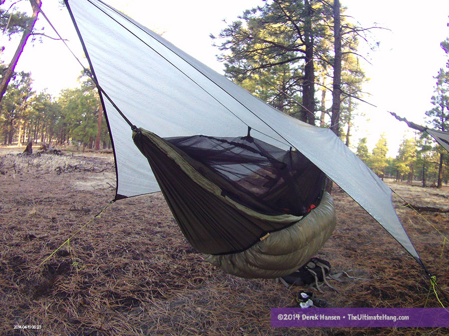 The Moskito Kakoon Hammock comfortably situated beneath a MacCat tarp.
