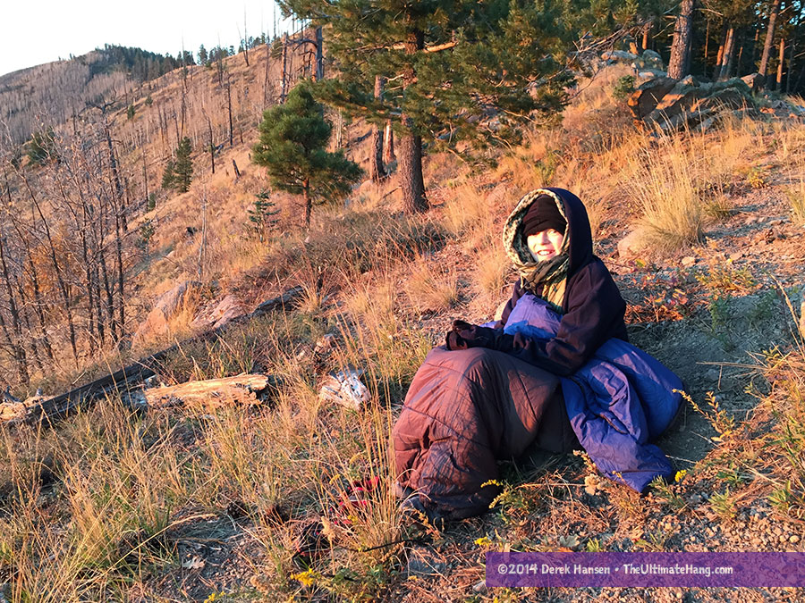 My son wrapped up in the Vesta on one of our backpacking trips.