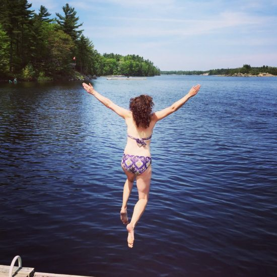 Girl jumping into a lake.   Learning about Cold Urticaria, it's causes, and how to prevent future attacks.