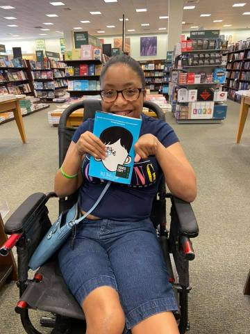 Picture of Author: Tylia Flores. How books that talk about disabilities have helped me.