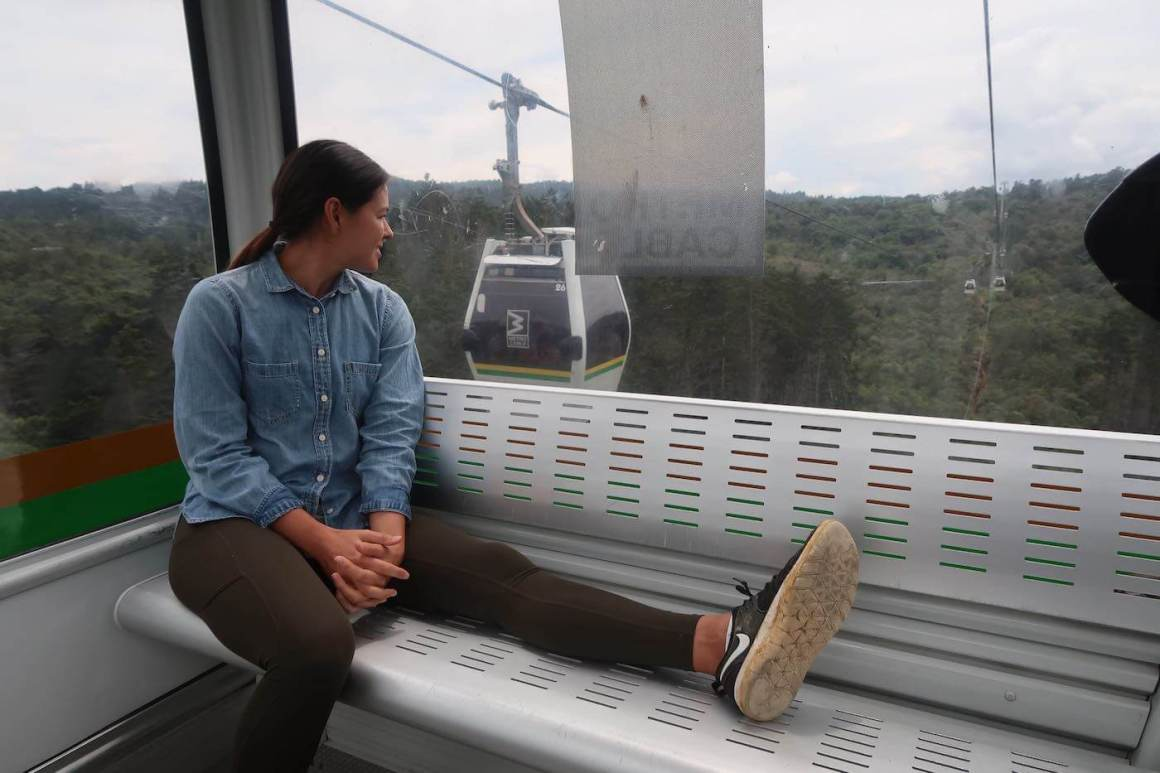 Kim sitting in Metrocable over Parque Arvi