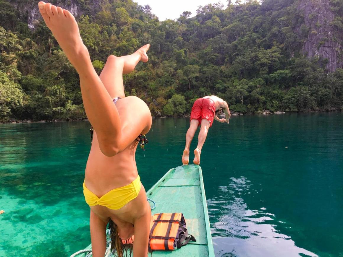 Playing around on our boat around Coron Island.