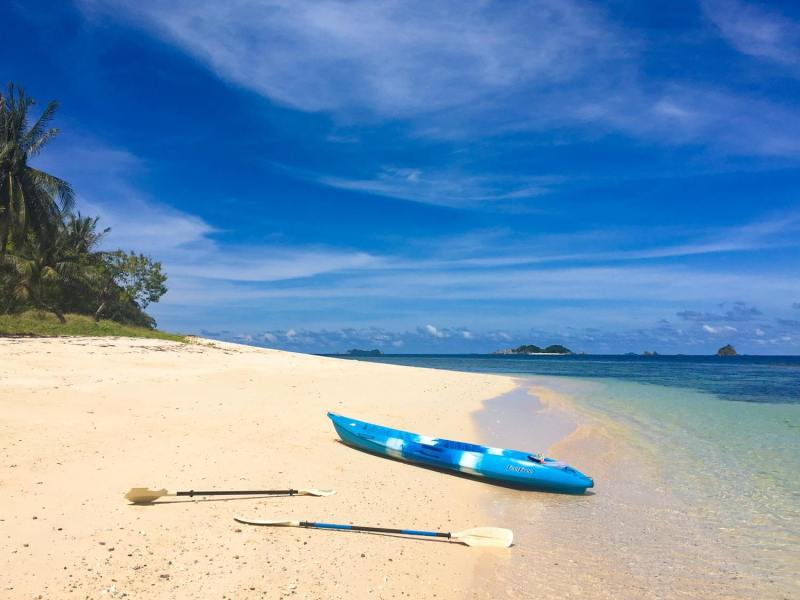 Things to do in Coron cover image of Kayak and paddles on island beach in north of Busuanga Island.
