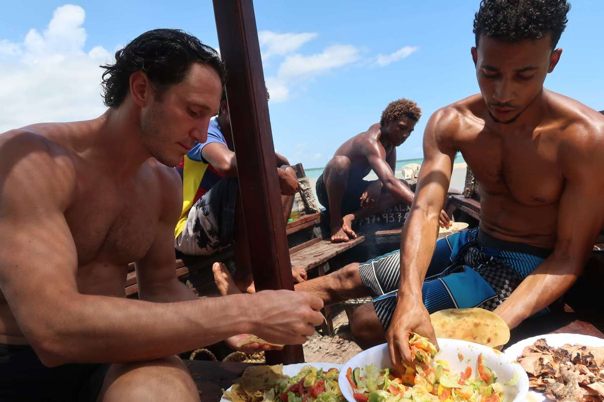 Chris, Jawad, and Awham pigging out on Jawad's boat
