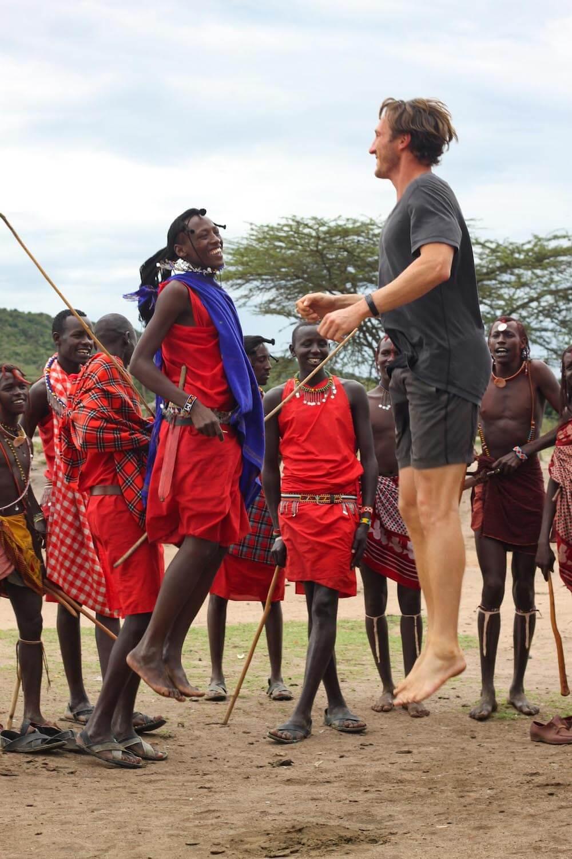 Chris and Maasai jumping by Maasai Mara