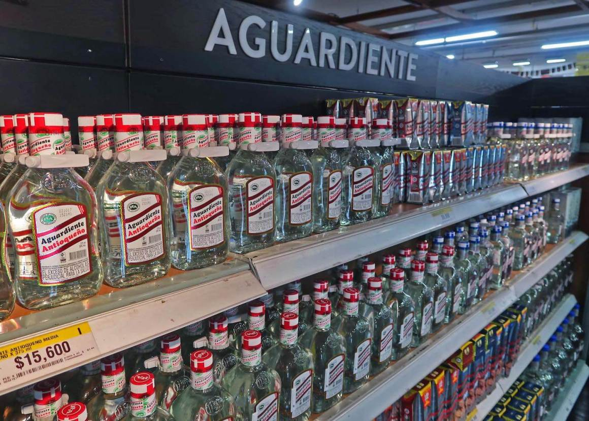 A shelf of aguardiente at Exito supermarket in Medellin