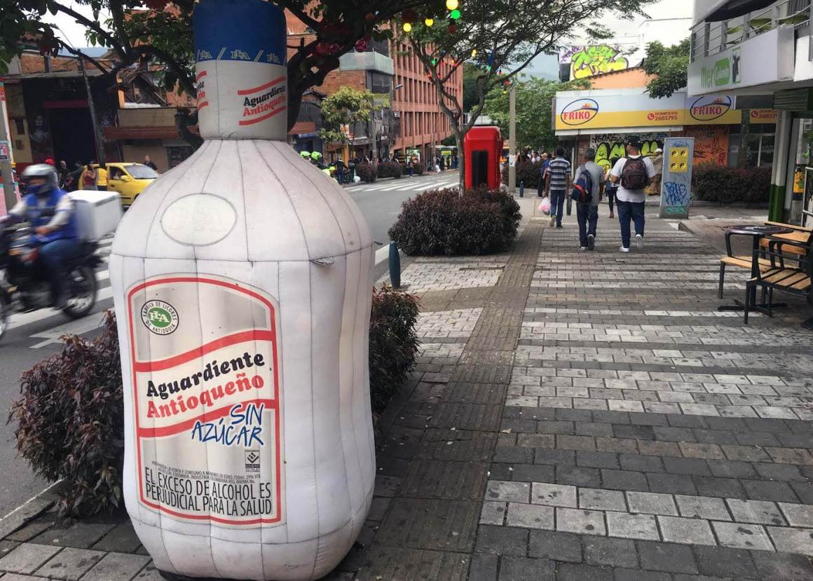 Inflatable bottle of aguardiente on Medellin sidewalk