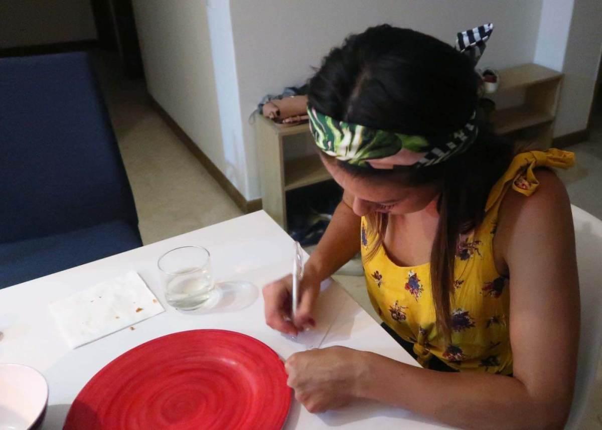 Kim writing down her aguardiente tasting notes