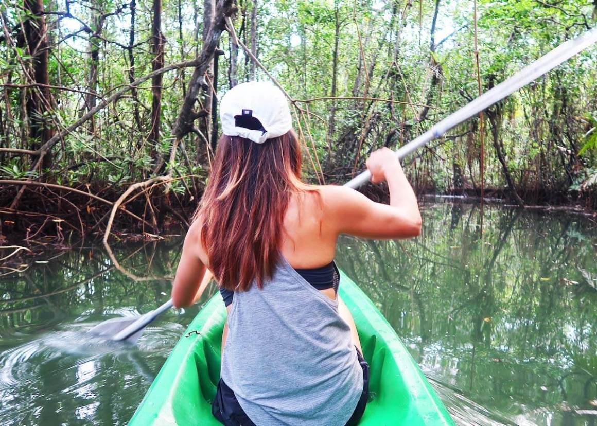 Kim at the front of the kayak paddling through mangroves, one of our favorite things to do in Bahia Solano