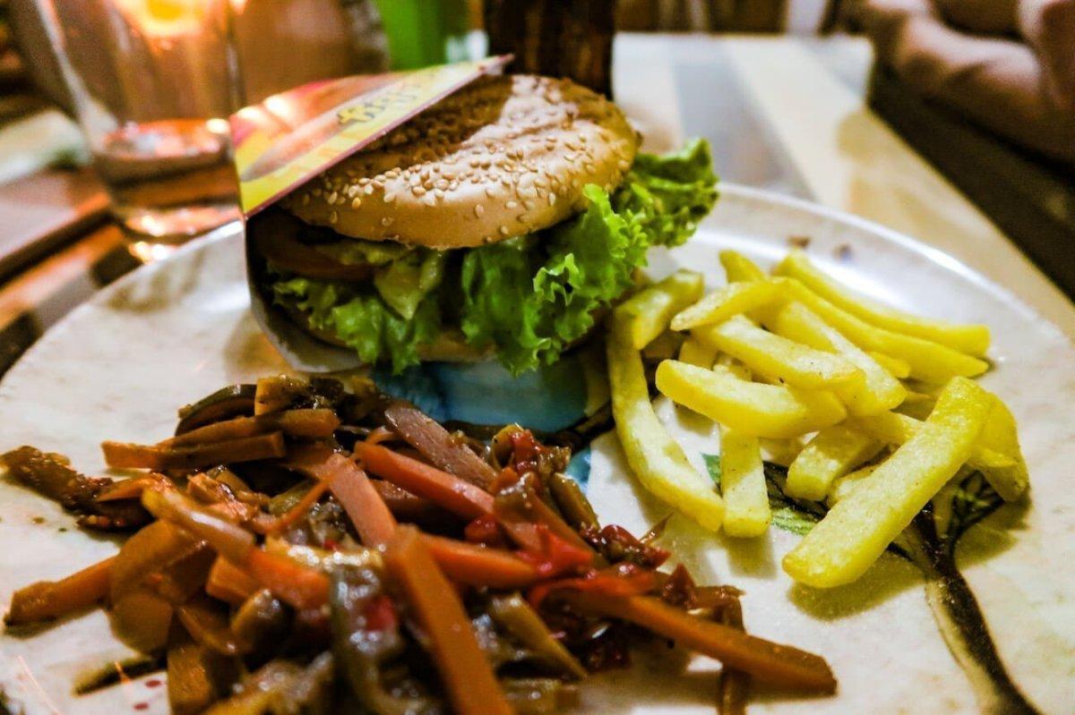 Close-up of burger, veggies, and fries