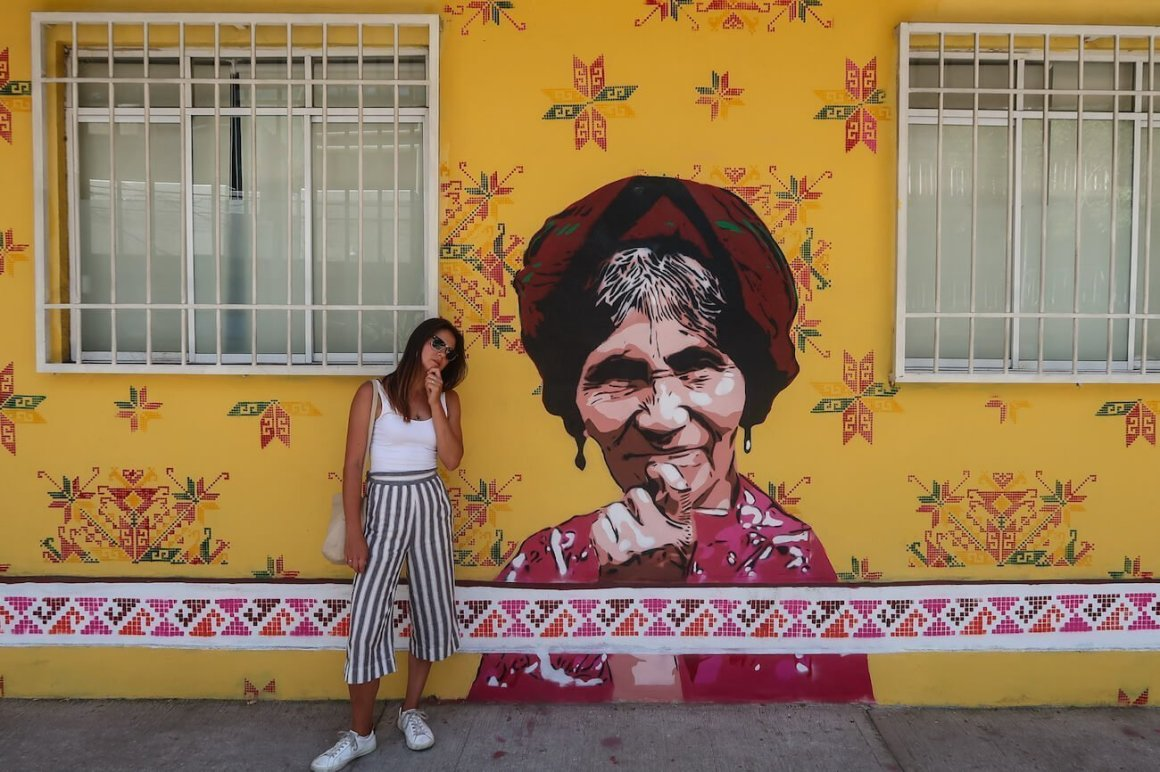 Kim wondering what to do on her Mexico City itinerary beside street art of a lady wondering too