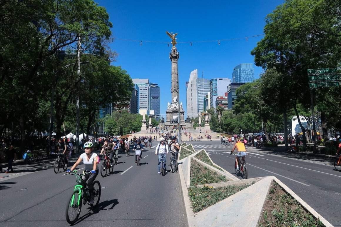 People biking during Ciclovia on Paseo de la Reforma