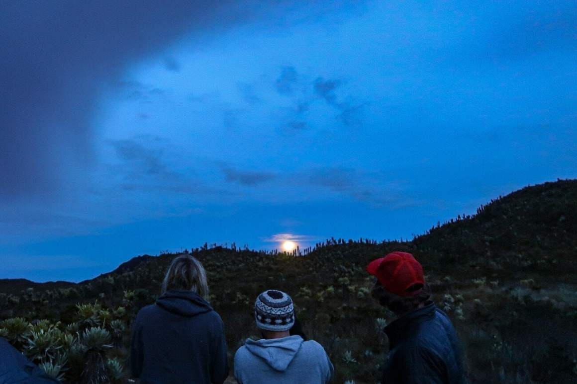 Chris, Jess, and Jorge looking at moonrise