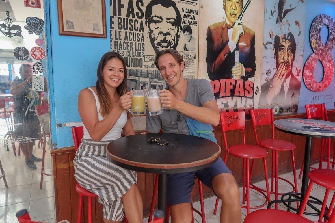 Chris and Kim cheersing their pulque at La Hija de los Apaches