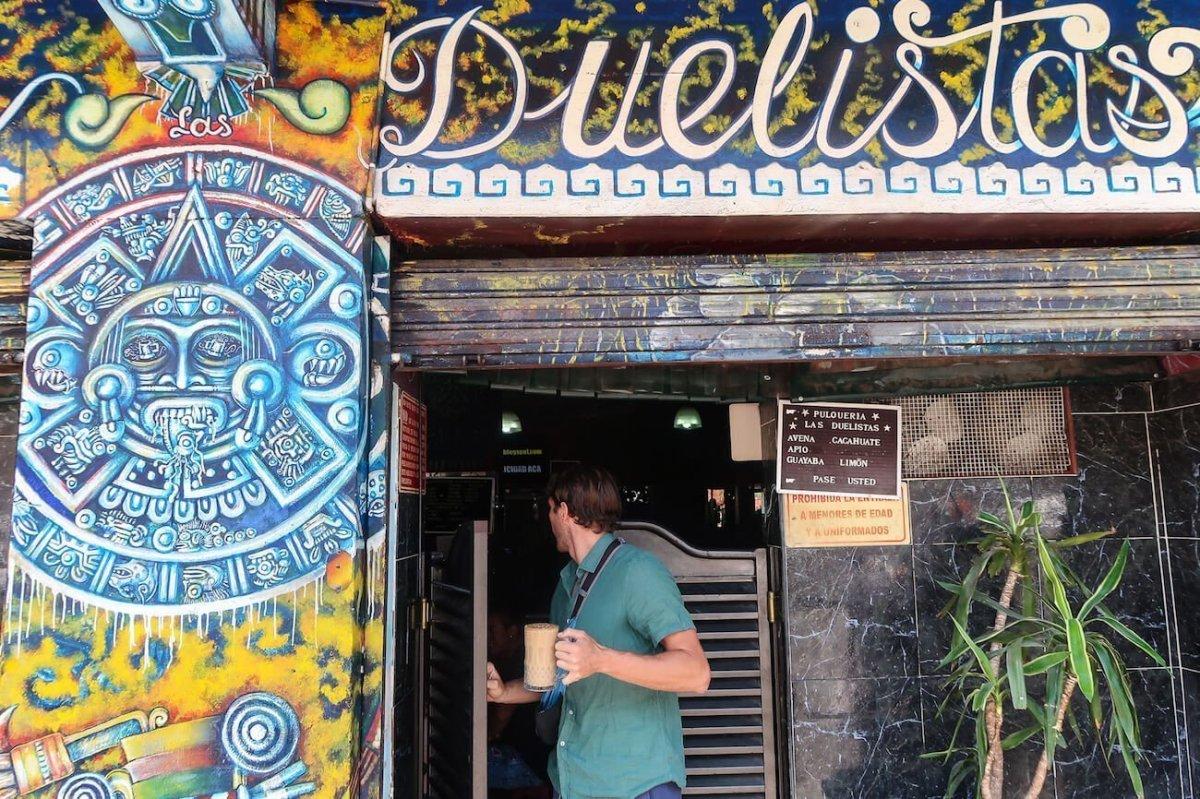 Chris walking into Pulqueria Duelistas