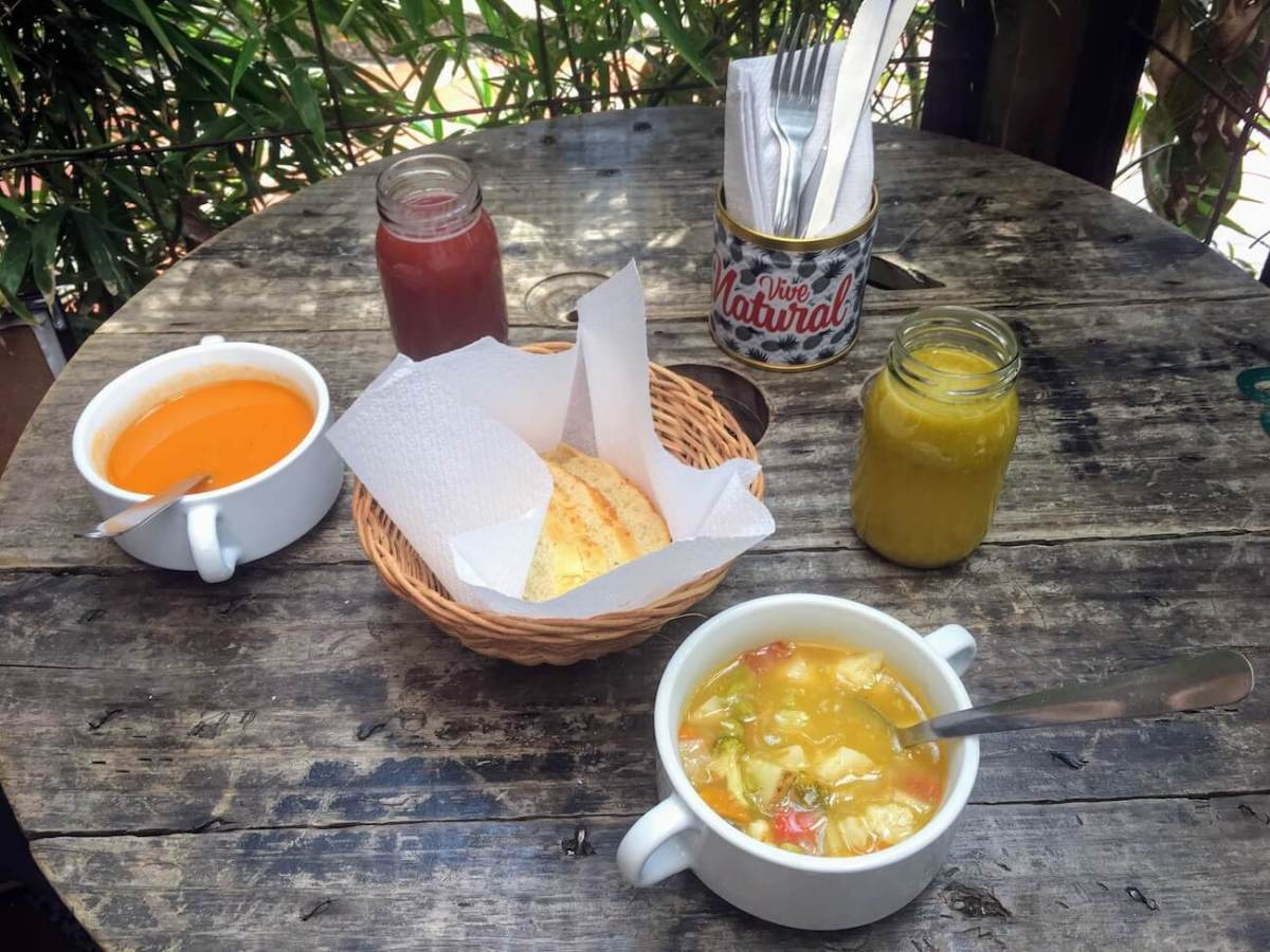 Close-up of juices, bread, and soups from Naturalia Cafe